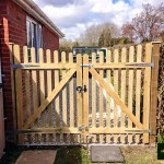 Pair of Custom Made Curved Top Picket Gates